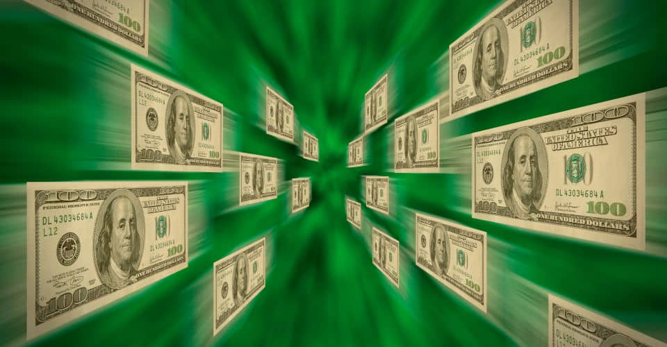100 bills flying through a green vortex